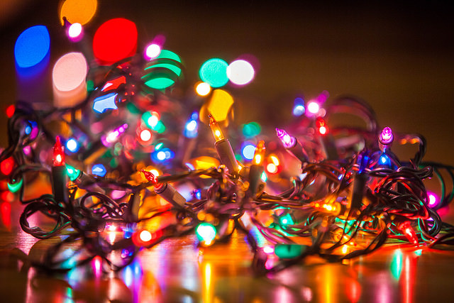 String of Christmas lights of many colors on the floor
