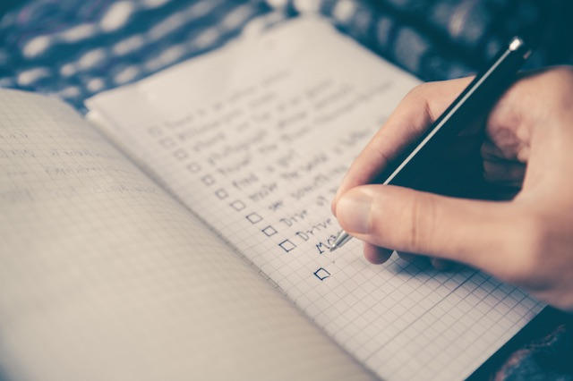 Person writing notes in a journal